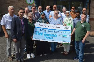 Members of the North West Islamic Association present a cheque for �2000 to James McMenamin, on the right manager of the Foyle Foodbank. Included in the photograph are staff from the foodbank, The donation is the proceeds from the recent Ramadan fast challenge.   DER2619GS-055