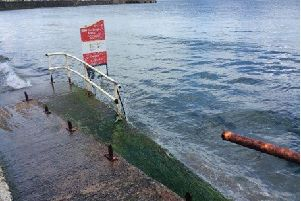 The sign erected by Mid and East Antrim Borough Council at Carnlough seafront.