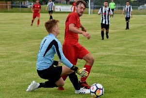 Melton Town's new signing Zac Munton is brought down for the second-half penalty which sealed a 2-0 win EMN-191007-132423002