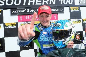 Dean Harrison celebrates his third straight win in the Solo Championship race at the Southern 100 on Thursday. Picture: Dave Kneen/Pacemaker Press.