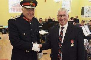 Former Director of Music of Sleaford Concert Band, Jim McQuade receiving BEM from Lord Lieutenant Toby Dennis in October of last year.