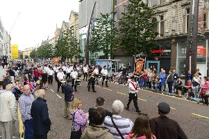 A part of the long Twelfth parade in the heart of Belfast yesterday, on Donegall Place. The march has extraordinary music, particularly the drums, yet there are never that many tourists watching it. July 12 2019