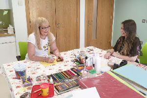 Shirley-Ann and Christina enjoying art therapy at the Macmillan Health and Well Being Campus, Altnagelvin Hospital