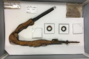 The warrior's sword broken to be buried alongside the man