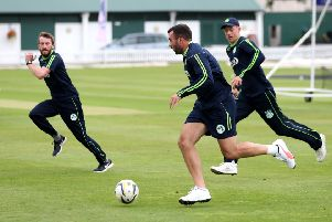 Ireland's Stuart Thompson (centre) warms up with a football during the nets session at Lord'. Pic by PA Wire.