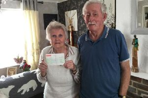 Rockinghorse Lotto agent Jeff Hayler (right) presented the cheque to Jean Street