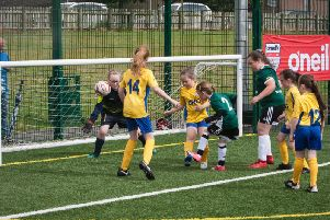 Derry City Ladies pull back a goal against Sion Swifts in the girls under-9 game at Caw on Monday.
