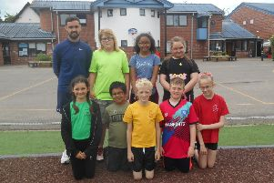 Pupils at Old Fletton Primary School who recently completed a sponsored walk with teacher Josh Pike