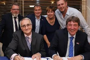 Peterborough United owners and Peterborough City Council officials sign the Memorandum of Understanding to complete the deal early this year. Front row, left to right, Cllr John Holdich, Dr Jason Neale, back, Cllr David Seaton, Stewart 'Randy' Thompson, PCC chief executive Gillian Beasley, Darragh MacAnthony. Photo: Joe Dent/theposh.com.