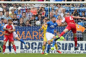 Mark Beevers (blue) in action for Posh against Fleetwood. Photo: Joe Dent/theposh.com.