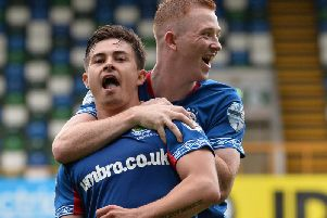 Linfield's Jordan Stewart celebrates with team-mate Shayne Lavery, after his stunning goal against Institute. Picture by Colm Lenaghan/Pacemaker Press