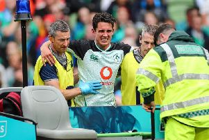 Ireland outhalf Joey Carbery suffers an ankle injury against Italy