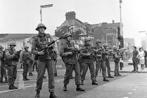 Some of the first soldiers to arrive in Northern Ireland at the start of the Troubles stand guard in the Falls Road area of riot-torn Belfast
