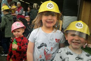 Nathaniel Linnett, Miriam Hanson-Jones, and brother William, are firefighters for the day at the Melton station open day EMN-190814-121229001