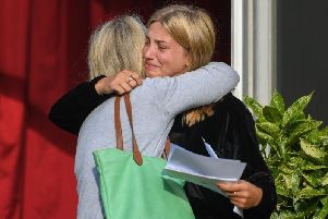 Lara Wells celebrates with her mum Emma after collecting her A Level results