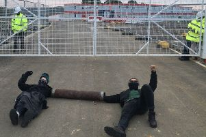 Wellingborough prison protesters attached themselves together with lengths of PVC pipe