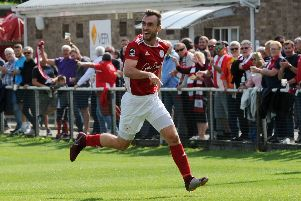Brackley Town's Shane Byrne celebrates after getting the only goal of the game against Altrincham. Photo: Jake McNulty