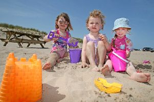 Children enjoy the glorious weather on Portstewart Strand. Photo: Steven McAuley/McAuley Multimedia