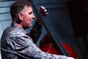 Paul Jefferies on his double bass (courtesy Ron Milsom) NNL-190821-092902001