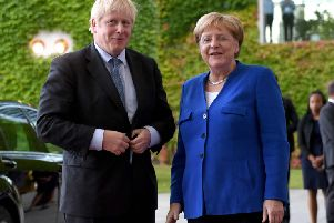 Prime Minister Boris Johnson meets German Chancellor Angela Merkel in Berlin ahead of talks. Stefan Rousseau/PA Wire