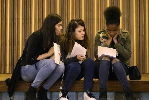 File photo dated 23/08/18 of students collecting their GCSE results, as around one in five GCSE entries are expected to score one of the three top grades this year, but just a tiny fraction of teenagers is likely to walk away with a clean sweep of 9s
