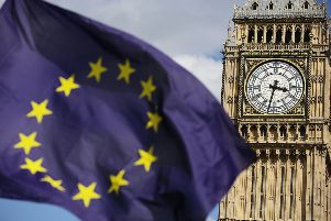 A European Union flag in front of Big Ben, London. Pic: Daniel Leal-Olivas/PA Wire