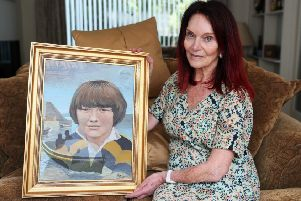 Mary Hornsey, at her home in Northern Ireland, holds a painting of her 15-year-old son Paul Maxwell, who was among the slain when the IRA blew up Lord Mountbatten's fishing boat off the coast of Mullaghmore in Co Sligo on August 27, 1979. Mrs Hornsey, has described the incident as a war crime.