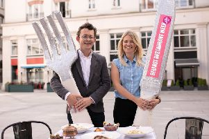 Gareth Neill of Destination CQ and Julie McCullagh of Belfast One celebrate the return of Belfast Restaurant Week in 40 restaurants across the City Centre from 23 to 29 September