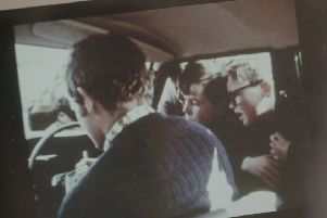 In footage which has never before been broadcast, Martin McGuinness is seen showing guns to young children and handing them bullets. Image: BBC Spotlight