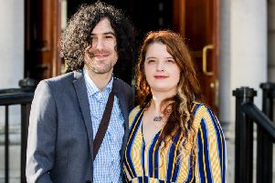 Emma DeSouza and Jake DeSouza outside the Royal Courts of Justice in Belfast. A tribunal has heard that people born in Northern Ireland are British citizens, unless they renounce that citizenship. (Photo: P.A. Wire/Liam McBurney)