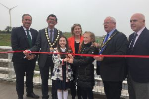 The red ribbon is cut to mark the official completion of the A6 dual carriageway.