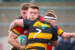 Lansdowne's David O'Connor is tackled by Conor Mitchell of Young Munster'.