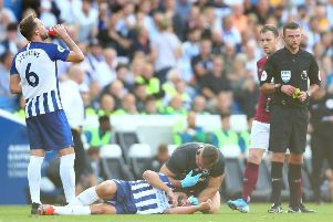 Neal Maupay receives treatment after a clash with Ashley Westwood (Getty)