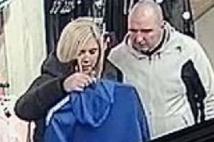 The couple posted on PSNI Belfast City Centre Facebook page - who officers want to speak to