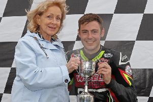 Jason Lynn receives the David Wood Memorial Trophy from Lee Wood. Picture: Derek Wilson/Pacemaker Press.
