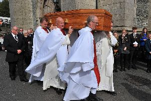 Priests from the Derry Diocese carry the coffin of Bishop Samus Hegarty from St Eugenes Cathedral, after Requiem Mass  yesterday afternoon, for burial in the cathedral grounds.