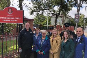 Carrickfergus Road Safety Committee has welcomed the new measures on the Belfast Road. Pictured are: (back) Joanne Campbell and Chris Shaw, PSNI; (front) David Hilditch MLA, Isobel Day, Beryl McKnight, Jenni Miller, principal of Carrickfergus Model , Cllr Cheryl Johnston and Roy Beggs MLA.