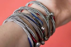 Some of the bracelets designed by Ash bass player Mark Hamilton using guitar strings from his friends in Snow Patrol