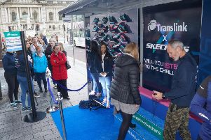 Translink passengers queued up to take part in the step challenge to be rewarded with a free pair of Skechers trainers. Photo by Aaron McCracken