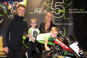 World Superbike champion Jonathan Rea with his wife Tatia, and children Jake and Tyler after he arrived back to Northern Ireland at Belfast International Airport on Wednesday.