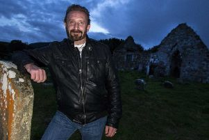 Paranormal investigator Stephen McKinley at Bonamargy Cemetery in Ballycastle