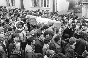 Willie Carlin (circled) in 1985 in the funeral cortege of an IRA man shot dead by the SAS in Strabane. Martin McGuinness is among those carrying the coffin