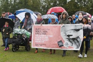 Anti-abortion campaigners marched through a cold and wet Falls Park in west Belfast yesterday. The Both Lives Matter protestors carried a banner saying 'North, South, East and West. We stand together for both lives, united against abortion'