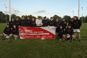 Buildbase branch manager Jamie Taylor with the Rasen U15s squad EMN-191014-130950002