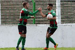 Robbie McDaid (left) and Navid Nasseri celebrating Glentoran's victory over Carrick Rangers. Pic by INPHO.