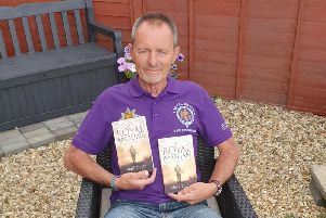 Mark Eagle with his new book.