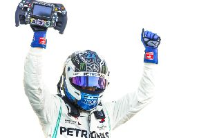 Valtteri Bottas celebrates his third win of the season EMN-191016-171615002