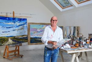 Martin Mooney at his studio in Donegal with a series of his landscapes