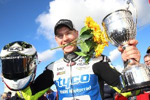 Christian Iddon celebrates victory in the Sunflower Trophy race at Bishopscourt in Co. Down on Saturday.