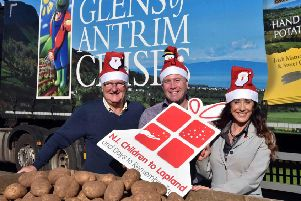 (l-r) Colin Barkley, chair, NI Children to Lapland and Days To Remember Trust; Michael McKillop, Managing Director, Glens of Antrim Potatoes; and Fiona Williamson, the charity's co-ordinator.